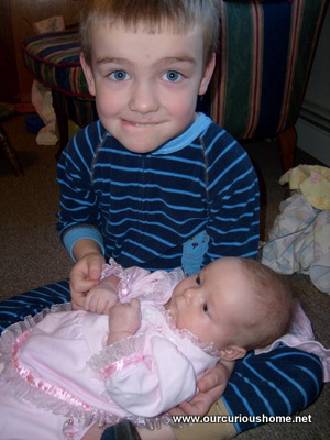 "M holding his little sister, wearing the ""I'm nervous"" face."