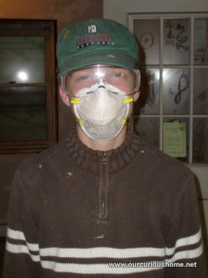 B with a dust mask and eye protection
