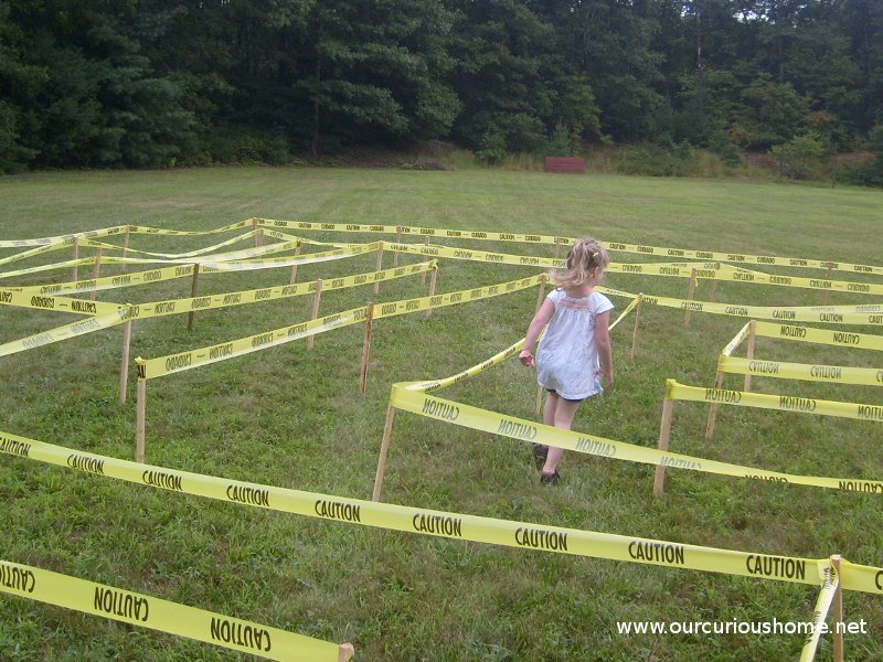 My littlest one walking through the caution tape maze. Only four years old, she solved the maze by climbing over caution tape in her way