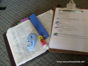Bible, decorative punch, glue stick, bookmarks, lesson outline
