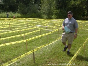 David C walking through the maze, map in hand, with a smile on his face.