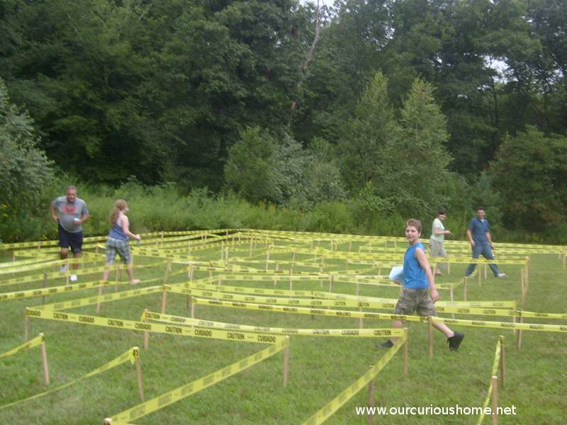 People walking through the Caution Tape Maze