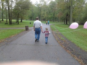 Daddad and K with movie set balloons