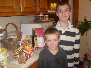 The boys by their gingerbread house
