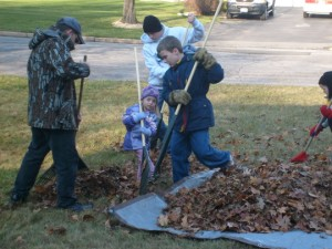 M and cousin raking