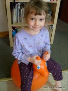 K on her bouncy pony