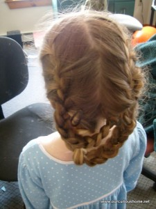 K's hair in two French braids