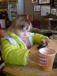 K with her cocoa cup
