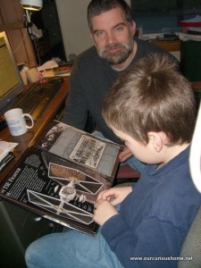 M reading a Star Wars Cross Section Book