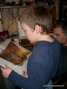 A view over M's shoulder as he reads a Star Wars book
