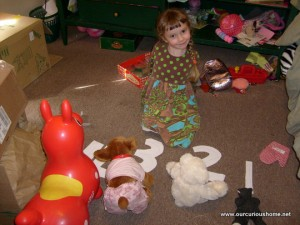 K showing her stuffed animals the numbers