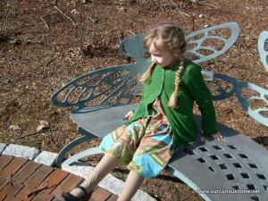 K resting on the dragonfly bench