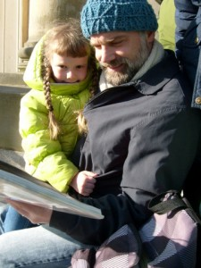 K and Daddy reading in front of the APL