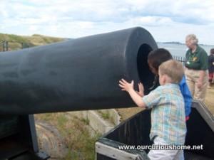 peeking into a cannon at Castle Island