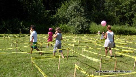 People Walking Through the 2013 Family Fun Fair Caution Tape Maze