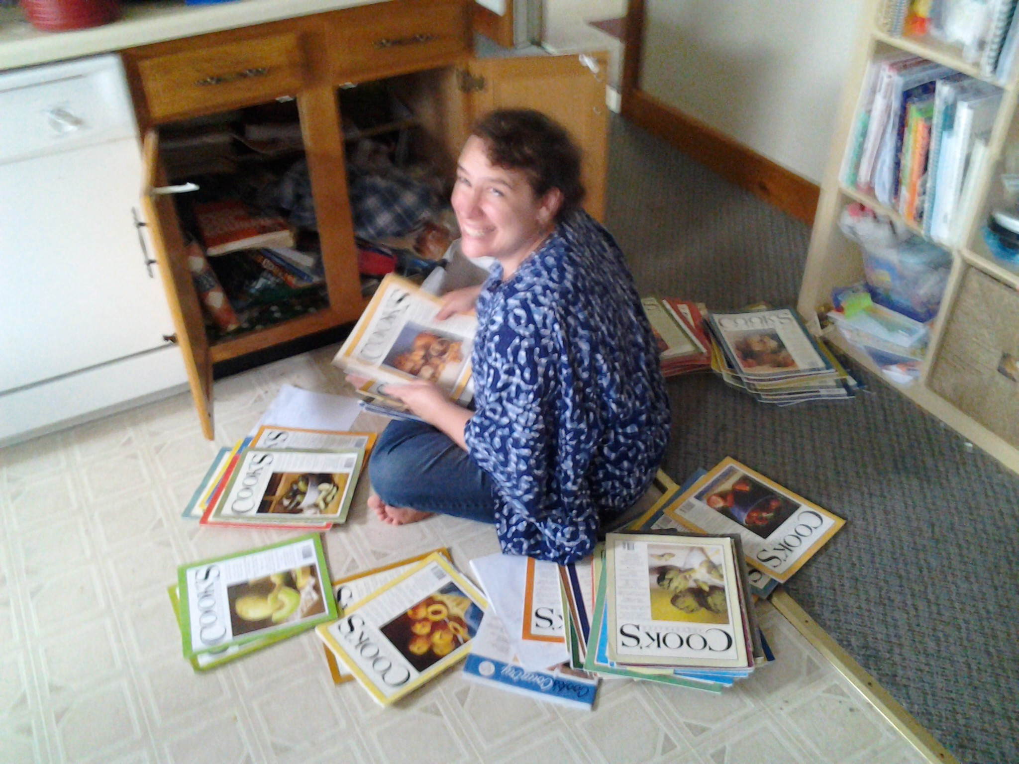Christine sorting cooks illustrated magazines