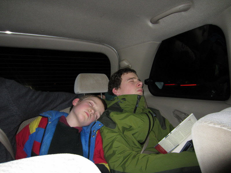 M and K asleep in the van