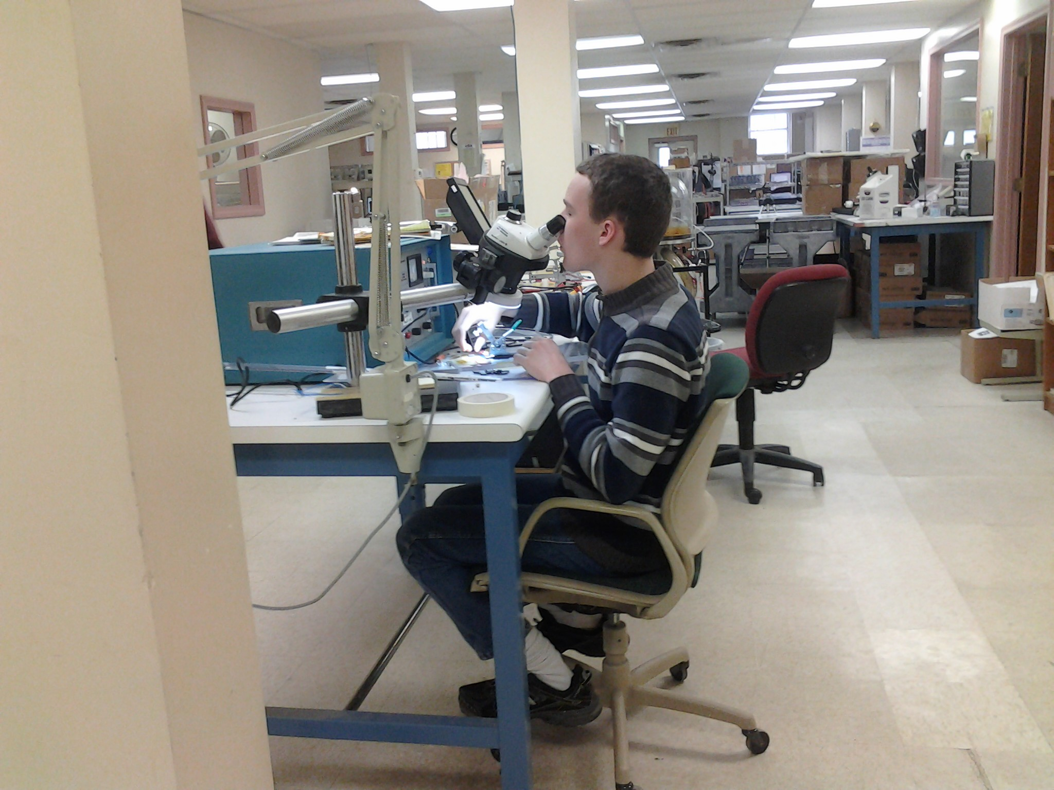 Ben using the sterio microscope at work