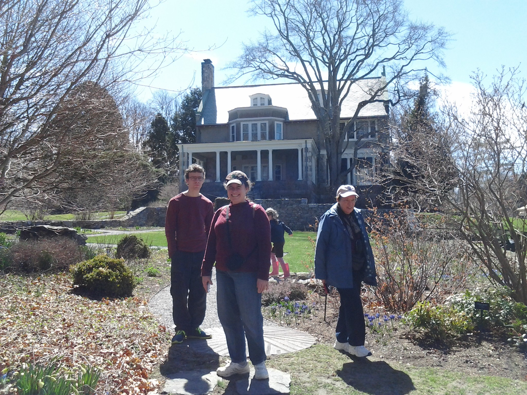 Ben, Me, K and Mom beside Blythwold Mansion, in the daffodil garden that wasn't blooming yet.