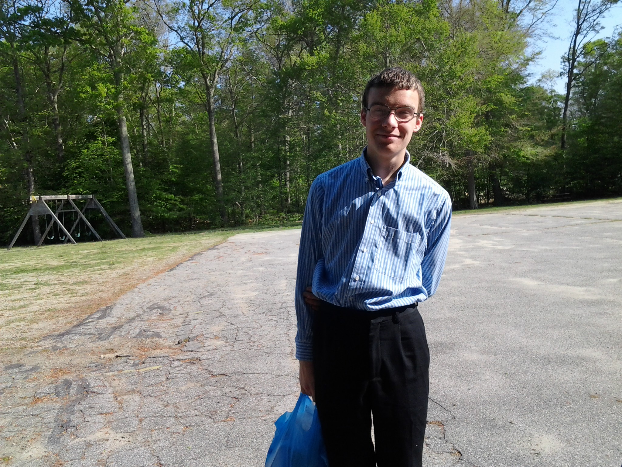 Ben in the church parking lot carrying left over coffee things from the testing coop to the deaconesses at our church since various homeschool groups use the coffee things anyway.