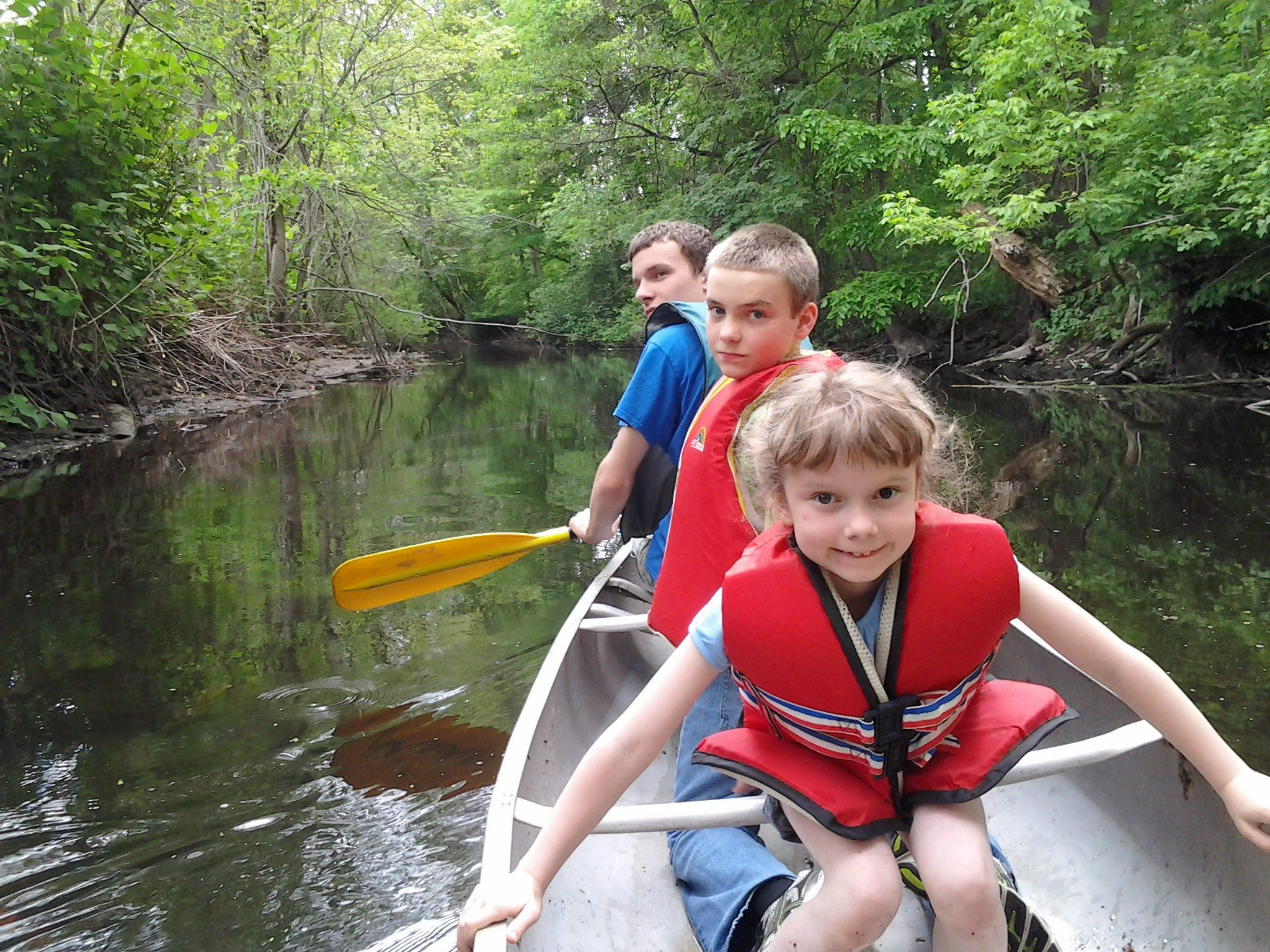 Ben, M and K in the canoe on the 10 Mile River