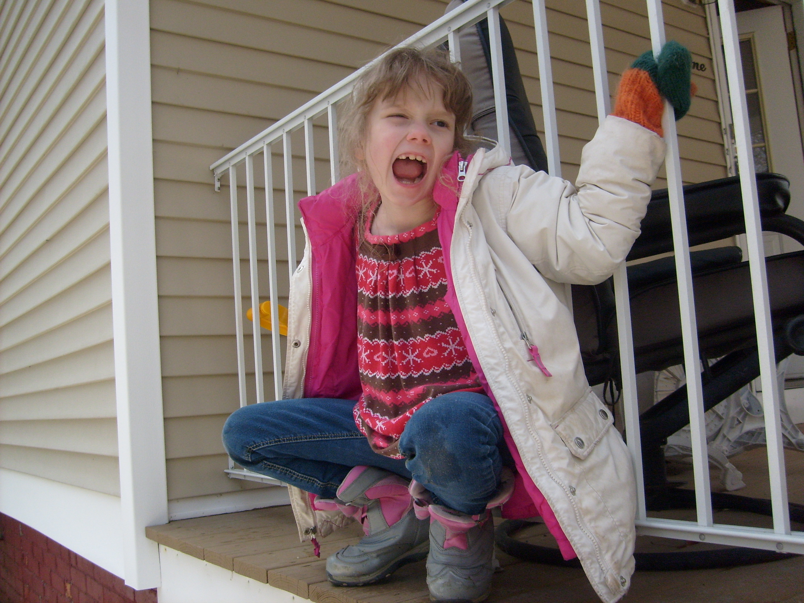 K hanging off the front porch railing pretending to be a gargoyle