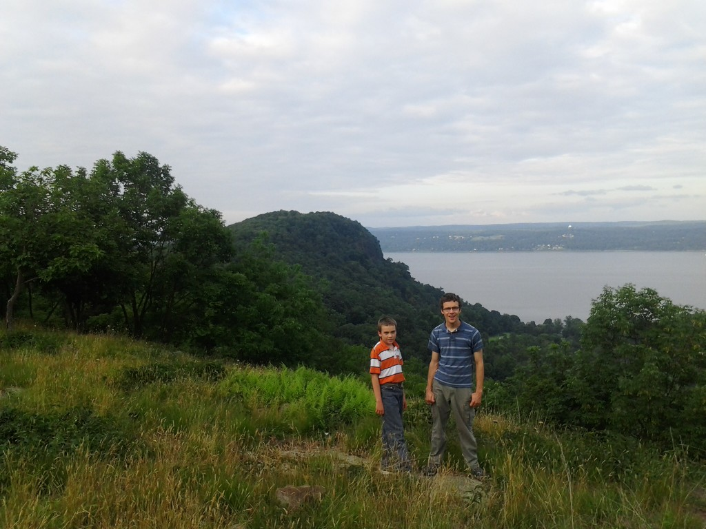 M and Ben on the hill behind my In-law's old house with Hook Mountain in the background and the Hudson River
