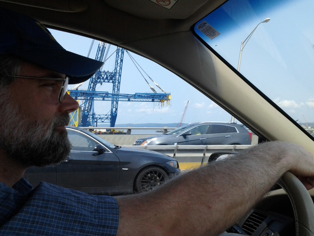 Dan driving home over the Tappan Zee Brige with new bridge in the background