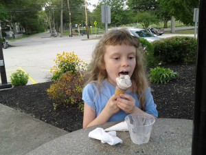 K licking an ice cream cone