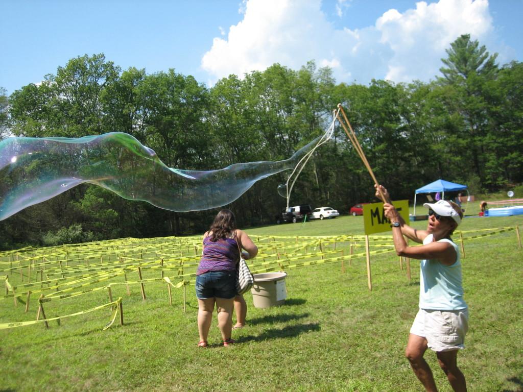 Linda makes giant bubbles near the maze.