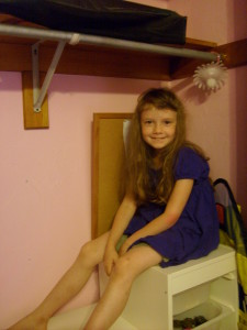 K sitting in her closet