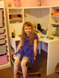 K at her desk
