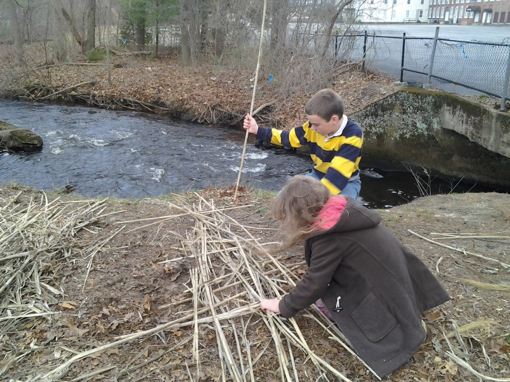 K and M weaving reeds to make the raft.