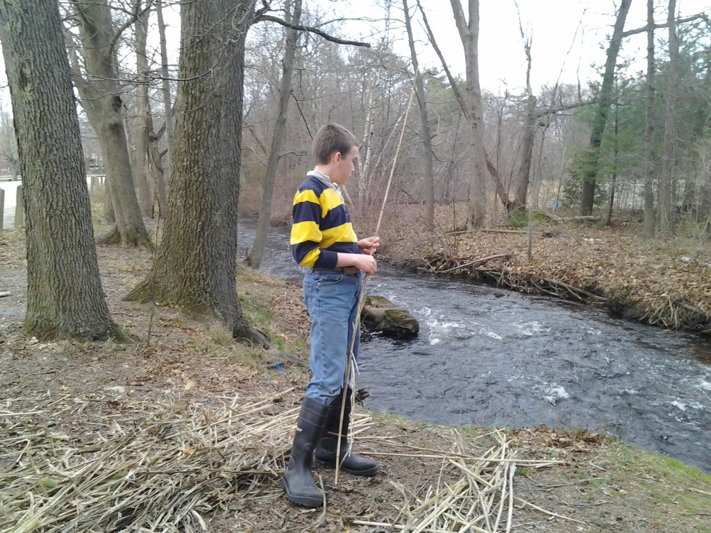 M looks at the Ten Mile River, which is moving rather rapidly.