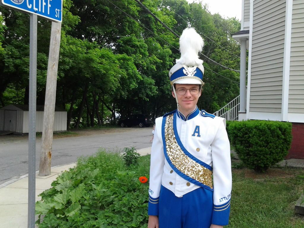 Ben in Band Uniform with Plume in the front garden when the poppy was blooming