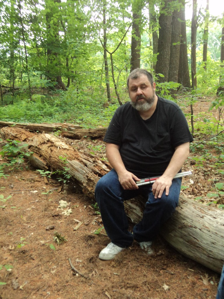 Warren resting on a log