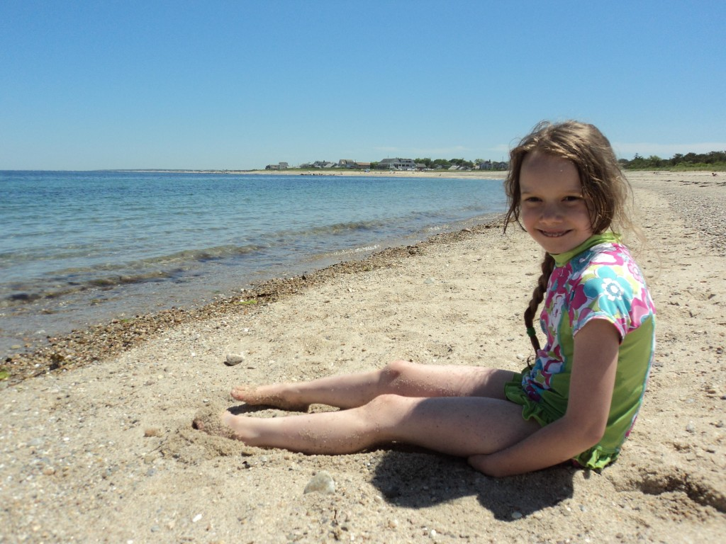 K sitting on the beach