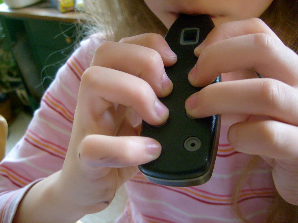 K playing Ocarina - I hoped she'd understand what I meant by cover the holes fully and completely if she saw a photo but then her form got better - maybe I had standardized testing on the brain.