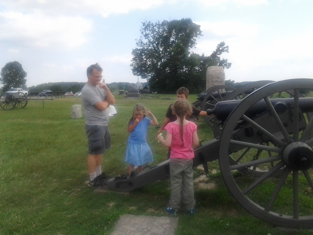 Jon and his kids with K at a cannon