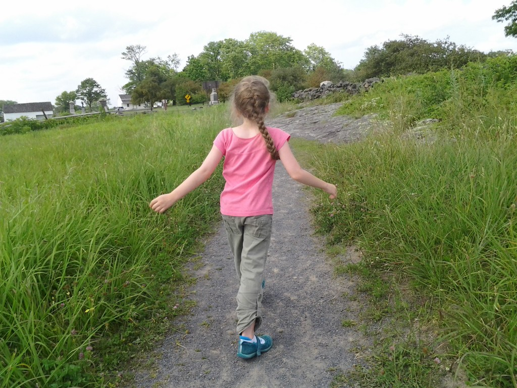 K walking up a path