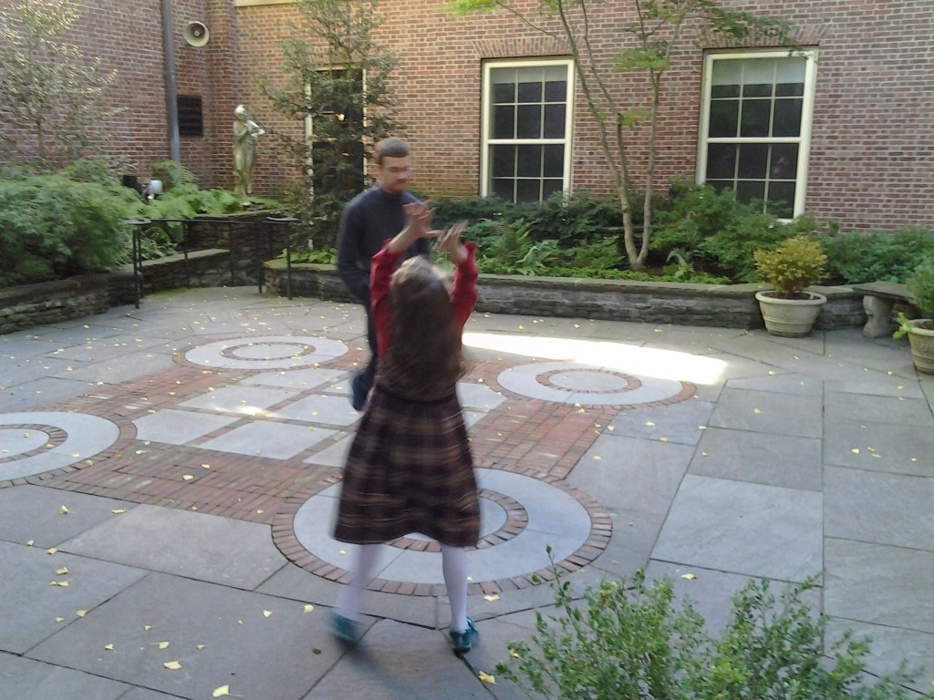 K dancing in the art museum garden