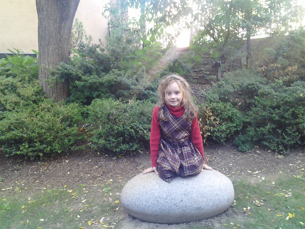 K sitting on what turned out to be a sculpture of Mirth