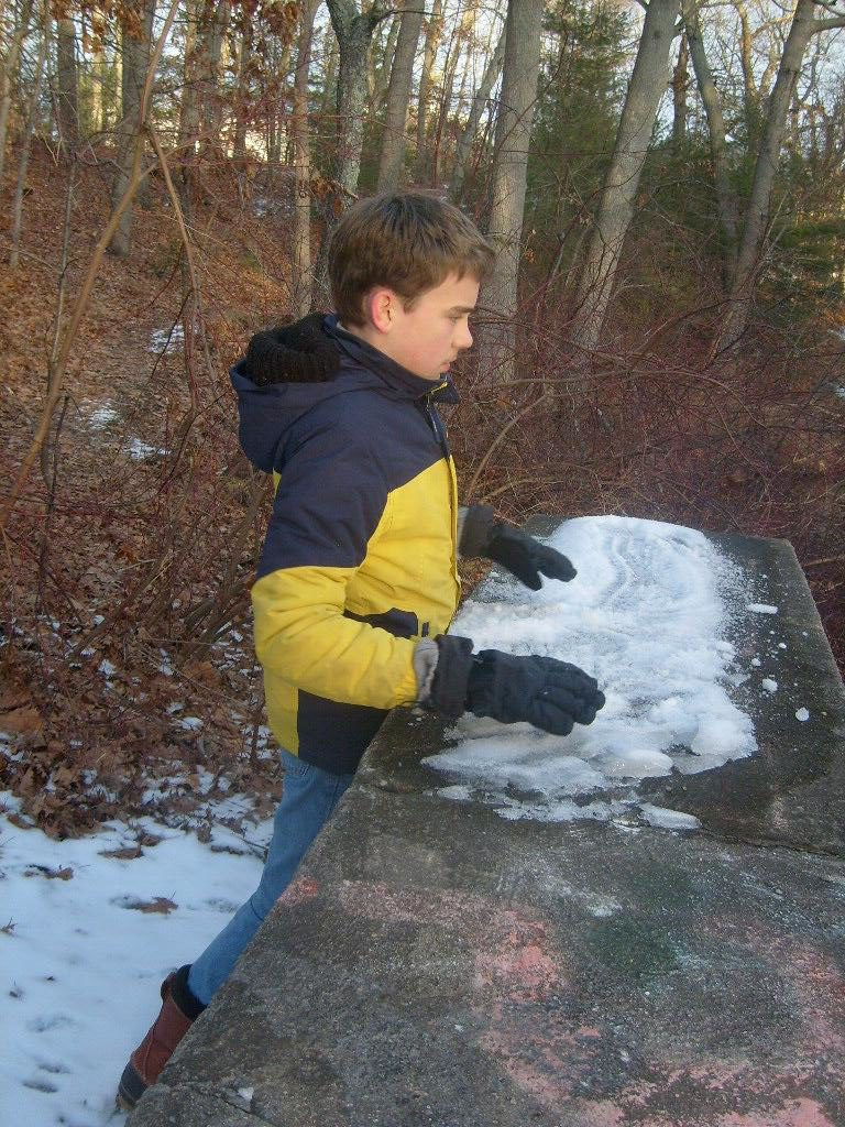 M watching his snowballs bounce off the waterfall