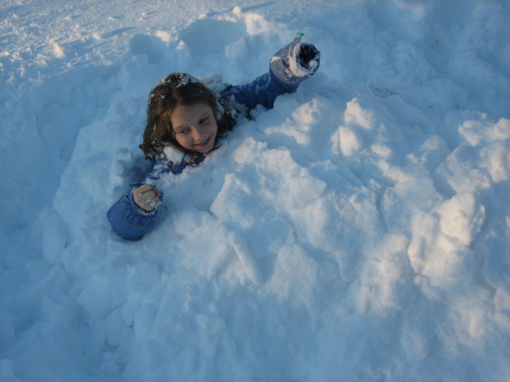 K climbing out of the snow