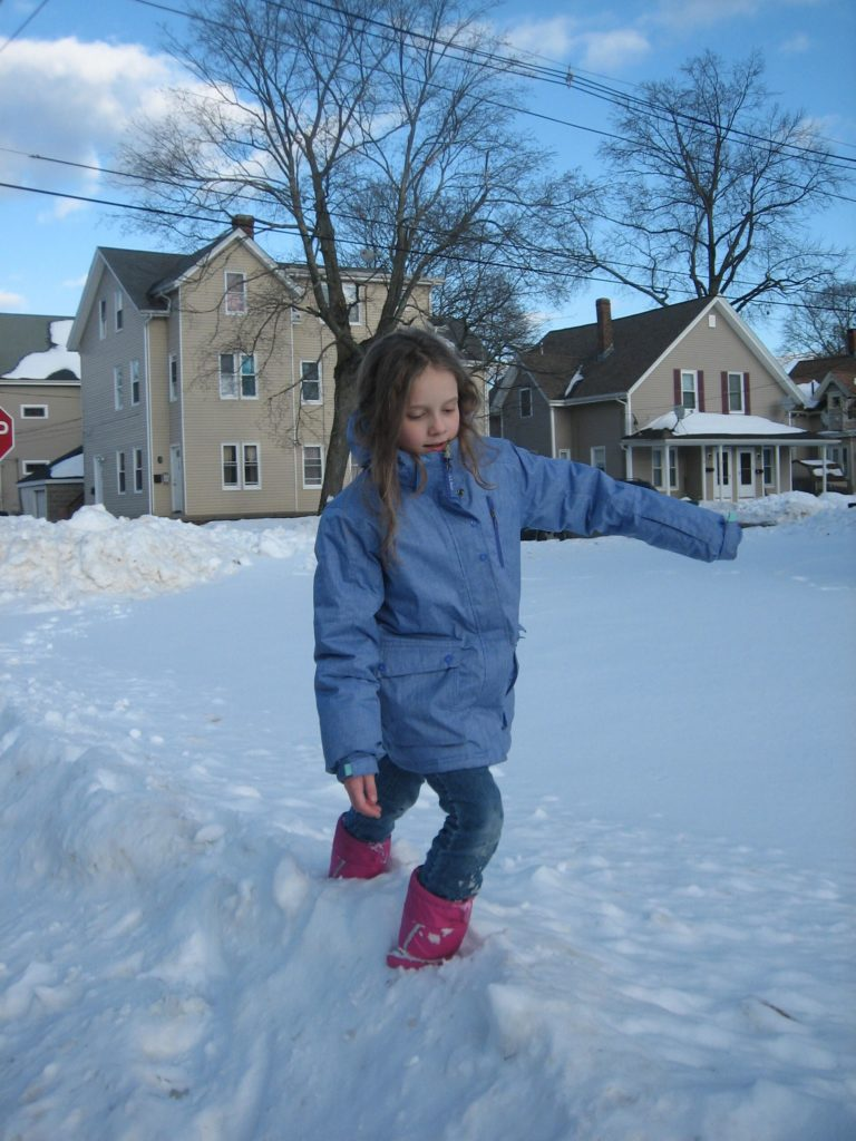 "K walking through a snowbank. She calls this photo ""Walking on the Himalayas"""