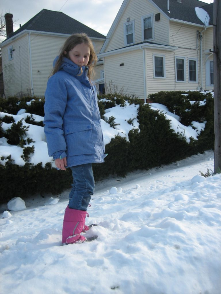 K looking dramatically down at the snow