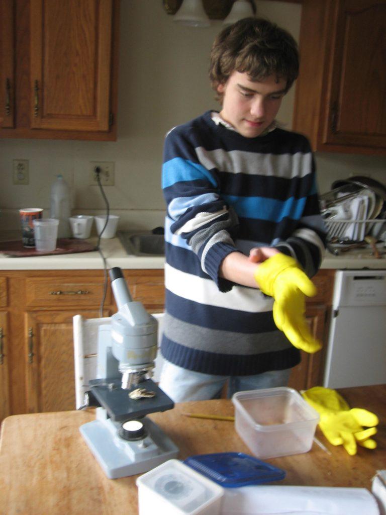 M adjusting the yellow dish washing gloves